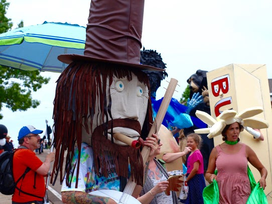 Participants donned outrageous costumes during the Cattywampus Puppet Parade at Open Streets Knoxville on Magnolia Avenue on May 21, 2017.