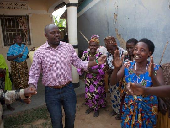 "Twesigye Jackson Kaguri meets with women in the ""Grannies"