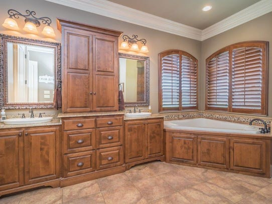 The master bath features custom wood finishes.