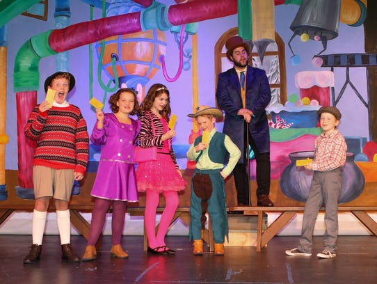 Willie Wonka (Mason Enfinger, top) greets contest winners (from left) Augustus Gloop (Cor Ellis), Violent Beauregarde (Aubrey Bryant), Veruca Salt (Alyson McClung), Mike Teevee (John Ellis) and Charlie Bucket (Xander Gleason).