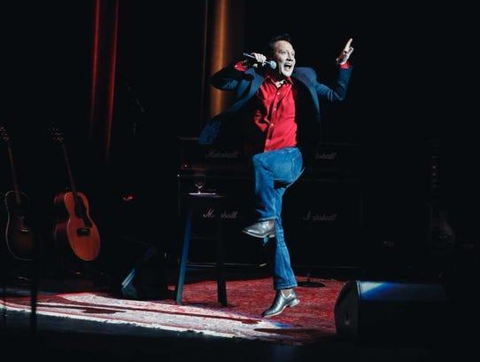 Rob Schneider performs.