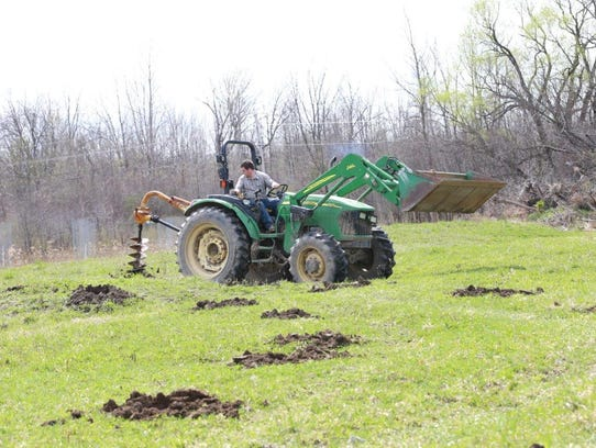 Seneca Army Depot owner Earl Martin works the land.
