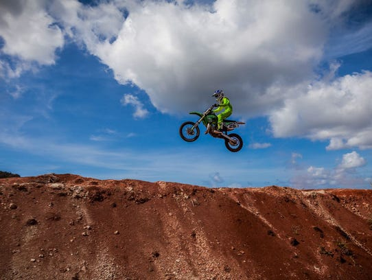 Lawrence Limtiaco, 12, gets some air while practicing for the spring 85cc MotoX series, which starts in July.