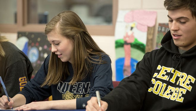Isabella Perron (Queens volleyball) and Stephen Perron (Centre, Ky., football) signed to play college sports on Friday