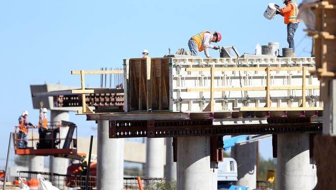 Construction personnel work on a support of the re-constructed Carolina Bridge in the Lower Valley. The project is funded by the Texas Department of Transportation.