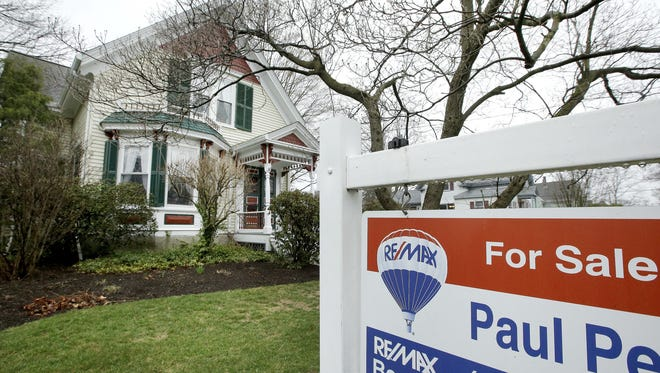 File photo taken in 2017 shows a home for sale in Natick, Mass.