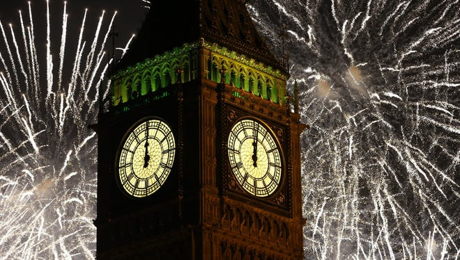 Fireworks explode over the clock known as 'Big Ben' housed in Elizabeth Tower, to celebrate the New Year in London, Thursday, Jan. 1, 2015.