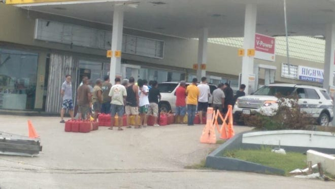 Saipan residents line up for gas on Aug. 03, 2015 after Typhoon Soudelor caused damage to the island.