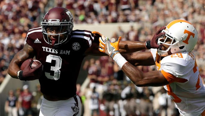 Texas A&M wide receiver Christian Kirk (3) breaks away from Tennessee defensive back Evan Berry (29) to score a touchdown after catching a pass during the first half of an NCAA college football game Saturday, Oct. 8, 2016, in College Station, Texas.