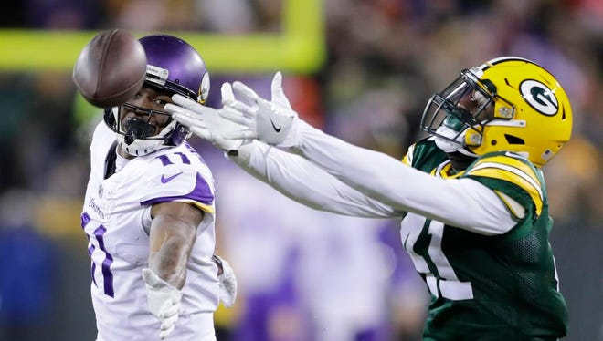 Green Bay Packers cornerback Lenzy Pipkins (41) can't reach the ball intended for Minnesota Vikings wide receiver Laquon Treadwell (11) at Lambeau Field on Saturday, December 23, 2017 in Green Bay, Wis.