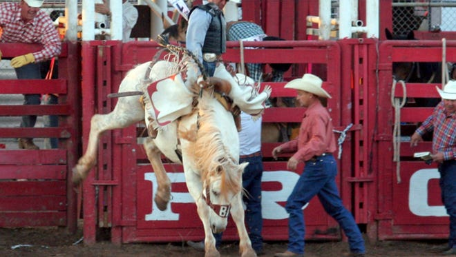 A bronc rider competes during the annual Santa Rosa Roundup south of Vernon. The Santa Rosa Roundup Association is hosting the 72nd annual event beginning May 17.