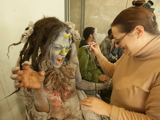 Shelton Martin gets some frightening finishing touches from makeup artist Ann Grimmette before joining the cast of chilling characters.
