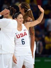 USA guard Sue Bird (6) celebrates after beating Spain