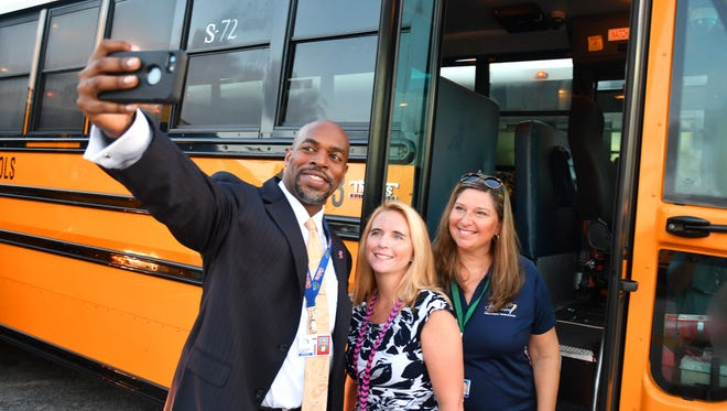 Dr. Desmond Blackburn, who is very social media savvy, takes a selfie with school bus aid Temple Micchella and school bus driver Jenni Jinright before rolling out on bus S72 to Riviera Elementary School.