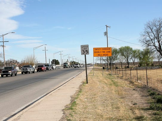 A sign alerts drivers of the safety corridor, March