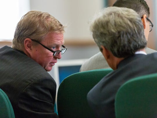 Thomas Clark, left, and John Day, attorneys for Tai Chan quietly converse during the second day of the murder trial at 3rd Judicial District Court on Tuesday, May 24, 2016. Chan is a former Santa Fe County sheriff's deputy accused of murdering a fellow deputy at Hotel Encanto de Las Cruces in 2014.