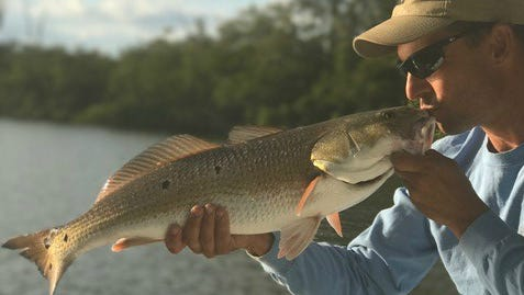 Anthony Burr, of Hobe Sound, caught and released this 29-inch redfish caught near Stuart in the Indian River Lagoon in 2016. Redfish like this, if bearing a special tag from the Coastal Conservation Association, could earn an angler a truck or a boat, motor, trailer package.