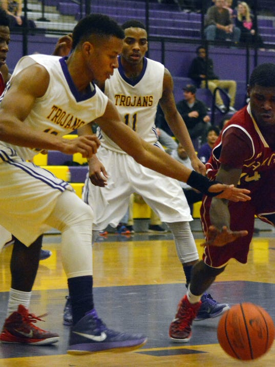 ANI ASH vs. Ouachita ASH's Keldric Stevens (10, left) and Ouachita Cephus G. (14, right) go after a loose ball Friday, Jan. 30, 2015.-Melinda Martinez/mmartinez@thetowntalk.com The Town Talk Gannett