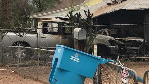 A car fleeing from Phoenix police crashed into another vehicle, sparking a fire that spread to a house on Mohave Street in Phoenix on July 14, 2018.