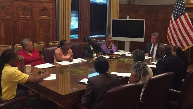 Members of the Yonkers African American Advisory Committee meet with Mayor Mike Spano on Sept. 14, 2016.