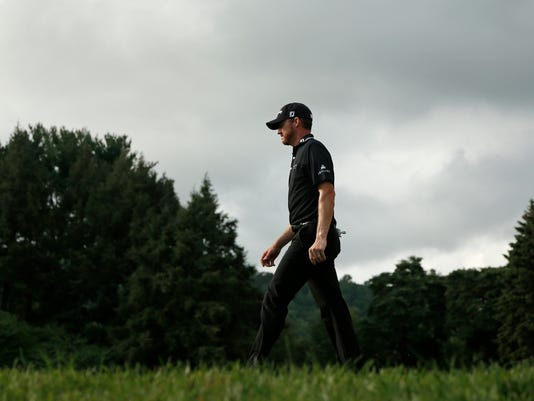 Jimmy Walker walks down the 13th fairway during the final round of the PGA Championship golf tournament at Baltusrol Golf Club in Springfield, N.J., Sunday, July 31, 2016. (AP Photo/Mike Groll)