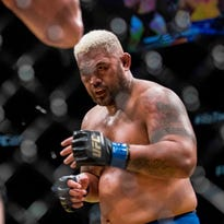LAS VEGAS, NV - JULY 08:  Mixed martial artist Mark Hunt stands on the stage during his weigh-in for UFC 200 at T-Mobile Arena on July 8, 2016 in Las Vegas, Nevada. Hunt will meet Brock Lesnar in a heavyweight bout on July 9 at T-Mobile Arena.  (Photo by Ethan Miller/Getty Images) ORG XMIT: 651654483 ORIG FILE ID: 545545588