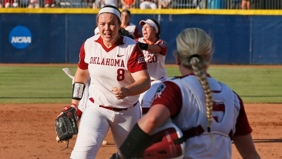 Oklahoma pitcher Paige Parker (8) pumps her fist after