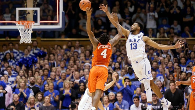 Duke's Matt Jones (13) blocks while Clemson's Shelton Mitchell (4) shoots as time expires during the second half of an NCAA college basketball game in Durham, N.C., Saturday, Feb. 11, 2017. Duke won 64-62. (AP Photo/Gerry Broome)