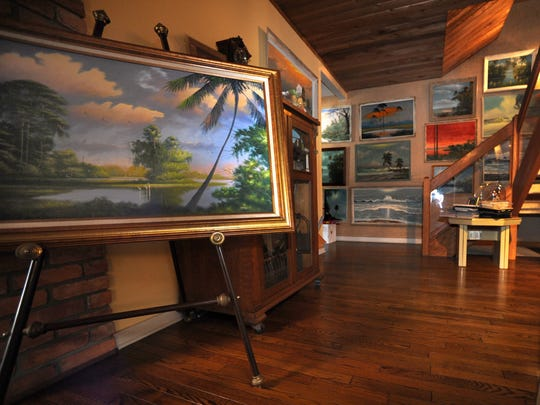 A gallery of The Highwaymen paintings decorates the