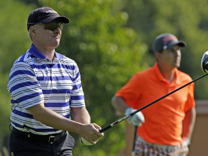 John Thorpe of Jacksonville, FL, hits a tee shot during the Post-Crescent/Fox Cities Amateur adult golf tournament Friday, July 18, 2014, at Reid Golf Course in Appleton, Wis.