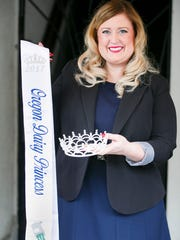 Jessica Kliewer, State Director and Dairy Princess Ambassador for the Oregon Dairy Women, holds on the crowns and sashes used for 2017 princesses. The Oregon Dairy WomenÕs 58th annual Oregon Dairy Princess- Ambassador Coronation Banquet is happening Saturday, Jan. 21, at the Salem Convention Center.