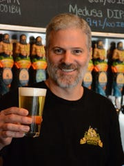 Partner Norm Scherner hoists a cold one at Riptide