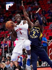 Detroit Pistons guard Reggie Jackson (1) shoots against Indiana Pacers guard Darren Collison (2) in the second half at Little Caesars Arena.