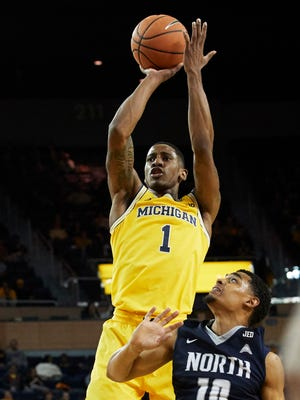 Michigan guard Charles Matthews (1) shoots over North Florida guard Osborn Blount (10) in the first half of U-M's 86-66 win on Saturday, Nov. 11, 2017, at Crisler Center.