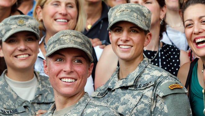 In this Aug. 21, 2015, file photo, Army 1st Lt. Shaye Haver, center, and Capt. Kristen Griest, right, pose for photos with other female West Point alumni after an Army Ranger school graduation ceremony at Fort Benning.