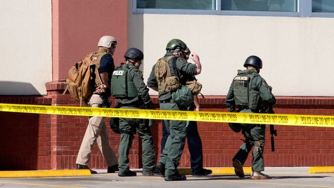 Members of the Corpus Christi Police Department's bomb squad prepare to search for a package left by a man at the CVS store on Alameda Street on Wednesday, March 7, 2018. Police responded to a call around 8:55 a.m. in which the man had made a bomb threat.