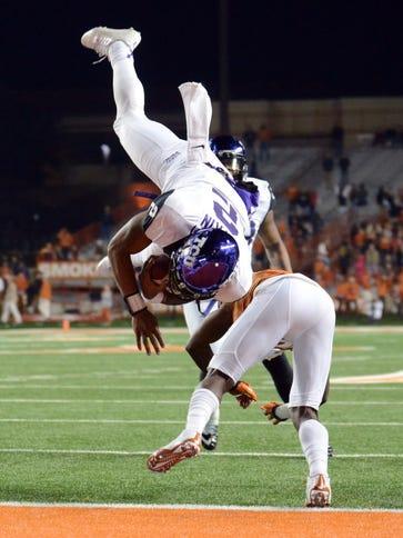 TCU quarterback Trevone Boykin (2) dives into the end