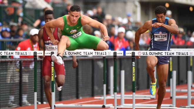 Jul 8, 2016; Eugene, OR, USA; Dondre Echols (left) and Devon Allen (middle) and Ryan Wilson (right) compete during the men's 1100m hurdles first round heats in the 2016 U.S. Olympic track and field team trials at Hayward Field. Mandatory Credit: James Lang-USA TODAY Sports
