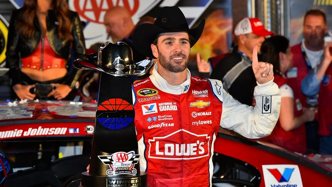 Jimmie Johnson celebrates winning the AAA Texas 500 Sunday at Texas Motor Speedway.