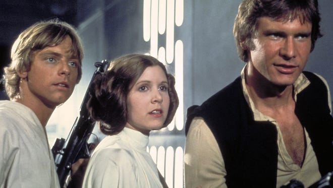 Carrie Fisher (center) starred as Princess Leia in the original 'Star Wars' trilogy alongside Mark Hamill (left, as Luke Skywalker) and Harrison Ford (Han Solo). The three are currently shooting 'Star Wars: Episode VII' in London.