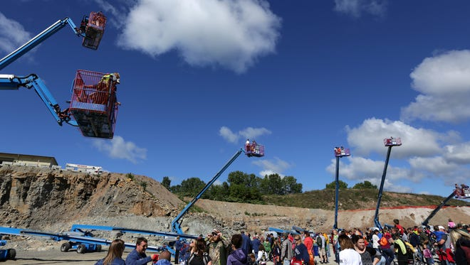 Visitors wait in line to get a ride on a lift during Quarry Quest on Sept. 12 at Michels Materials Quarry in the Town of Neenah.
