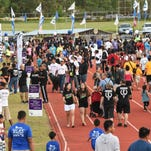 In this file photo, throngs of people participate in the American Cancer Society Relay For Life. This year's event is on Friday.
