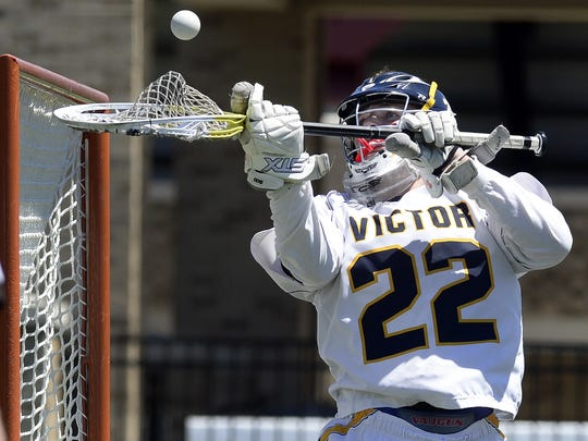 Victor goalie Chayse Ierlan controls the ball after making a save during the Class B Western Regional played at St. John Fisher College on Saturday, June 3, 2017. Victor advanced to the Class B state semifinal with a 7-4 win over Hamburg-VI.