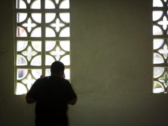 A student looks out a window at Escuela Superior JoseŽ Campeche in San Lorenzo, Puerto Rico.