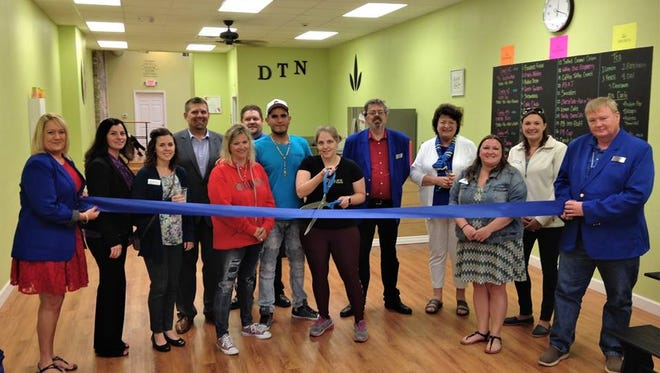 People gather for Downtown Nutrition's ribbon-cutting ceremony on June 26 in downtown Sheboygan.