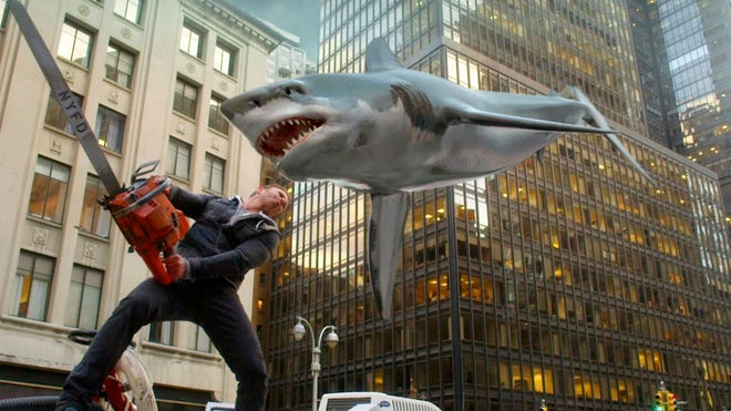 Ian Ziering, as Fin Shepard, battles a shark on a New York City street in a scene from 'Sharknado 2: The Second One.' One more time: This is not real.