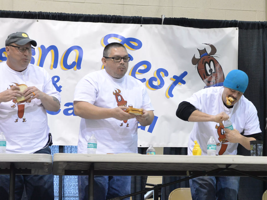 "From left, Richard ""The Anvil"" Anderson of Cleona and Garry ""Jambalaya"" Turina and Stephen ""Barracuda"" Hillegass, both of Lebanon, compete in The Bologna Eating Contest at the 8th Annual Lebanon Rotary Club Bologna Fest & Winter Carnival. The event was held at the Lebanon Valley EXPO Center and Fairgrounds on Saturday, January 27, 2018."