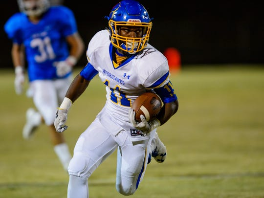 Tyrese Franklin runs the ball for Wren last week against Pickens.