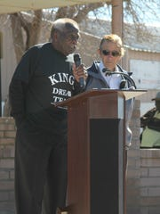 Martin Luther King Jr. Scholarship Foundation president James Williams (left) speaks at the special ceremony following the annual march.