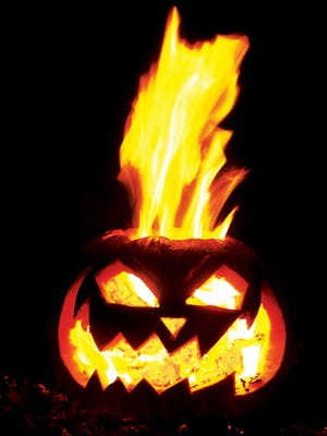 Jack blows his stack in a fiery jack-o-lantern carved by an SIU Edwardsville, Ill., student, Monday Oct. 27, 2014, in Alton, Ill.